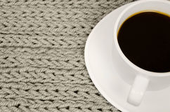 Cup of coffee stand on knitted background. Stock Photo