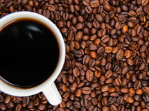 Cup of coffee standing on the grains Stock Photo