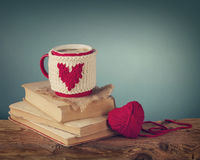 Cup of coffee standing on an old book stock image