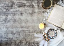 Cup of coffee staying by the book, candle, dream catcher on the royalty free stock image