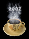 Cup of coffee and steam 2007. Isolated on black Royalty Free Stock Photo