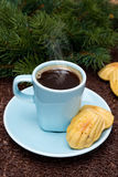 Cup of coffee with steam and cookies madeleines Royalty Free Stock Photos
