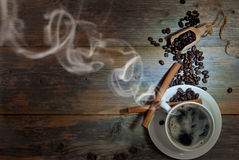 Cup of coffee with steam Stock Photos