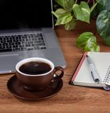 Cup of Coffee with Steam on a Desktop stock photography