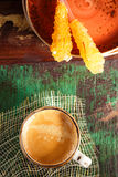 A cup of coffee with stick sugar  and glitter Stock Photography