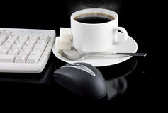 Cup of coffee-still-life. Cup of coffee, part of keyboard,mouse on black background stock images