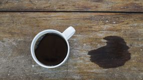 A cup of coffee and strain. A cup of coffee on wooden board Stock Images