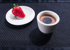 Cup of coffee and strawberry. Cup of coffee and a strawberry on black background. Texture vector illustration