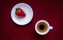 Cup of coffee and strawberry. Cup of coffee and a strawberry on red background. Texture vector illustration