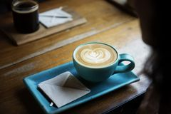 Cup of coffee in stylish rectangular saucer  Royalty Free Stock Photography