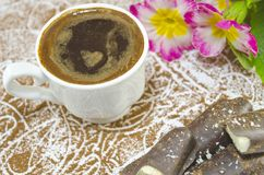 Cup of coffee with a subtly heartshaped foam Royalty Free Stock Photos