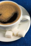 Cup of coffee and sugar Stock Photography