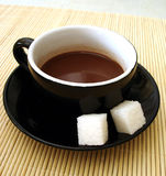 Cup of coffee with sugar Stock Photography