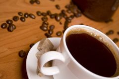 Cup of coffee, sugar and beans Stock Photography