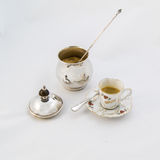 Cup of coffee and sugar bowl. Set of cup coffee for espresso and nickel silver sugar bowl with brown sugar stock images