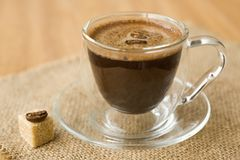 Cup of coffee, sugar, coffee beans Stock Photos