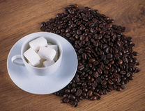 Cup of coffee, sugar and coffee beans Royalty Free Stock Photo