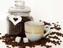 Cup of coffee, sugar and coffee beans Royalty Free Stock Photos