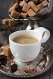 Cup of coffee, sugar cubes and chocolate candy on old wooden background Royalty Free Stock Image