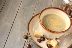 Cup of coffee, sugar cubes and chocolate drops on old wooden background with copy space Stock Photography
