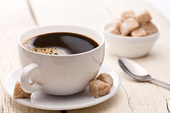 Cup of coffee with sugar cubes. Stock Image