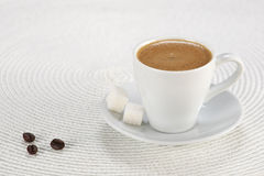 Cup of coffee, sugar cubes on a white wicker a mat Royalty Free Stock Photo