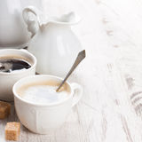Cup of coffee with sugar cubs and milk jug Royalty Free Stock Photography