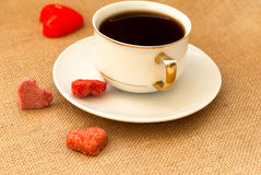 Cup of coffee and sugar hearts Royalty Free Stock Images