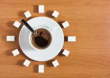 Cup of coffee with sugar like a clock Royalty Free Stock Photos
