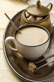 Cup of coffee and sugar on a metal tray Stock Photo