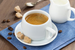 Cup of coffee with sugar and milk jug Royalty Free Stock Photos