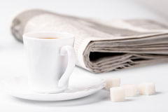 Cup of coffee, sugar and newspapers Royalty Free Stock Images