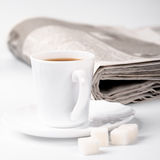 Cup of coffee, sugar and newspapers Stock Photography