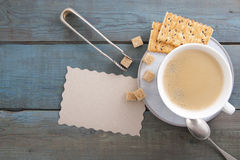 Cup of coffee and sugar on old wooden boards. Royalty Free Stock Photos