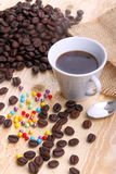 Cup of coffee and sugar pearls. Cup of coffee on wood with sugar pearls and jute cloth Stock Photography