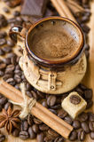 Cup of coffee with sugar and spices Stock Image
