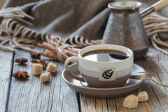 Cup of coffee with sugar and spices and a wooden box with grains Stock Photo