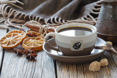 Cup of coffee with sugar and spices and a wooden box with grains Stock Images