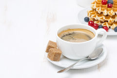 Cup of coffee with sugar and waffles (with space for text). Horizontal royalty free stock photography