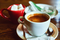 Cup of coffee. And sugar on a wooden table Royalty Free Stock Photos