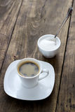 Cup of coffee with sugar on wooden table Stock Image