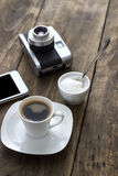 Cup of coffee with sugar on wooden table Royalty Free Stock Photography