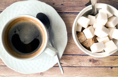 Cup of coffee and sugar on a wooden table Stock Photography