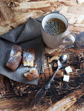 A Cup of coffee ,sugars and metal spoon, biscuits sprinkled with sugar on a napkin Stock Photos