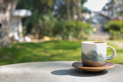 Cup coffee and sunny trees background Royalty Free Stock Image