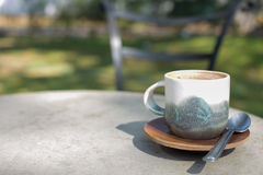 Cup coffee and sunny trees background Royalty Free Stock Photo
