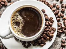 Cup of coffee surrounded by coffee beans. Top view. Royalty Free Stock Photos