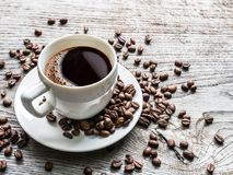Cup of coffee surrounded by coffee beans. Top view. royalty free stock photography