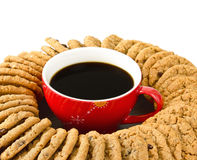 Cup of coffee surrounded by cookies Stock Images