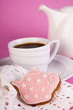 Cup of coffee with sweet bisquit. Cup of coffee and sweet bisquit on pink background Stock Image